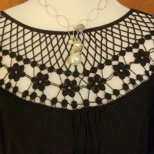 Gorgeous black blouse with crocheted neckline